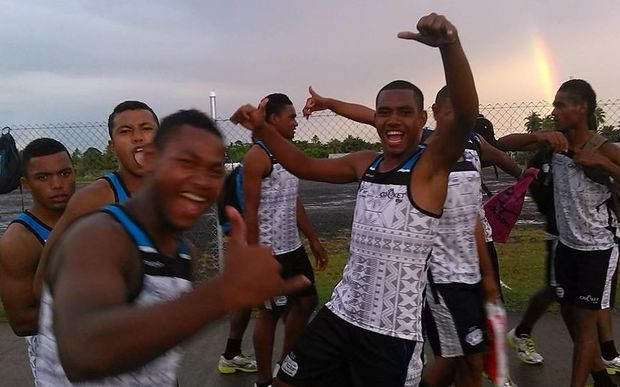 The Fiji Under 19 cricket team celebrate beating Papua New Guinea.