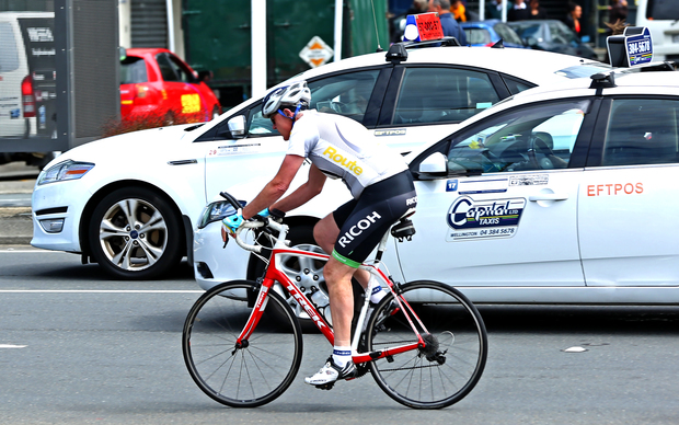 Cyclist in Wellington traffic.