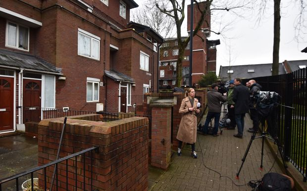 "Journalists gather outside a residential address in London where Kuwaiti-born Mohammed Emwazi, identified by experts and the media as ""Jihadi John"", is once believed to have lived."