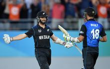 Kane Williamson celebrates with Trent Boult.