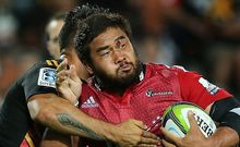 The Crusaders' Ben Funnell is tackled by by Chiefs' captain Liam Messam in their Super Rugby Match.