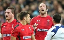 Alun Wyn Jones speaks to referee Jaco Peyper during Wales Six Nations rugby match against France in Paris.