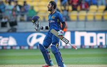 Lahiru Thirimanne celebrates his century.