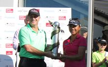 John Key presents Lydia Ko with the trophy.
