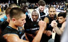 The Breakers huddle during their first semi-final game.