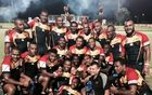 PNG Hunters players celebrate beating the Northern Pride in pre-season.