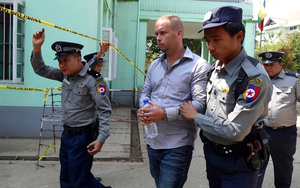 New Zealander Philip Blackwood being led into a court in Yangon, Myanmar.