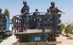 Armed oil police in blue camouflage uniforms on back of flat bed truck.