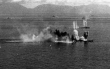 US Navy Task Force 38 aircraft attack Japanese battleship Musashi (foreground) and a destroyer in the Sibuyan Sea, 24 October 1944.