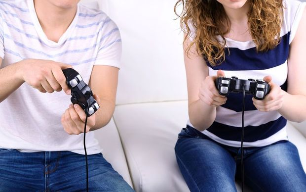 The report says boys are more likely than girls to play video games and to spend time on the computer and internet.