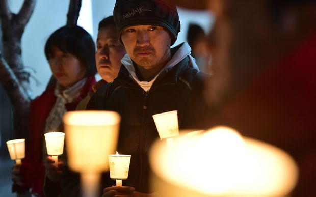 South Koreans hold a vigil to wish for Mark Lippert's quick recovery.
