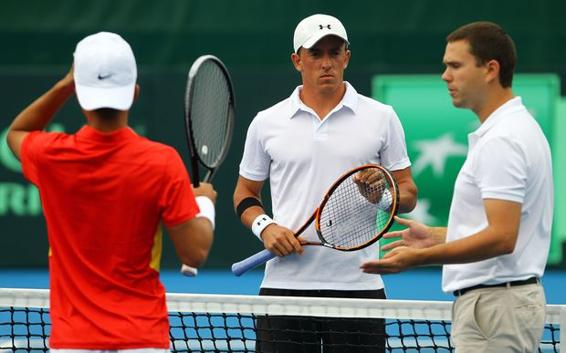 Rubin Statham faces Chinese No.2 Di Wu across the net before the opening Davis Cup singles rubber