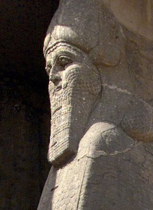 The ancient statue of a winged bull with a human face, an indication of strength in the Assyrian civilization, at the archaeological site of Nimrud,