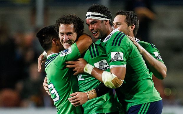 Marty Banks is swamped by his Highlanders team-mates after kicking the match-winning penalty