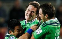 Marty Banks celebrates his match-winning penalty with his Highlanders team-mates
