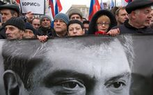 Russia's opposition supporters carry a banner bearing a portrait of Kremlin critic Boris Nemtsov.