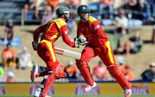 Zimbabwe's Brendan Taylor (R) and Sean Williams in action at the World Cup