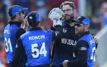 Daniel Vettori celebrates the wicket of Nawroz Mangal with team mates.