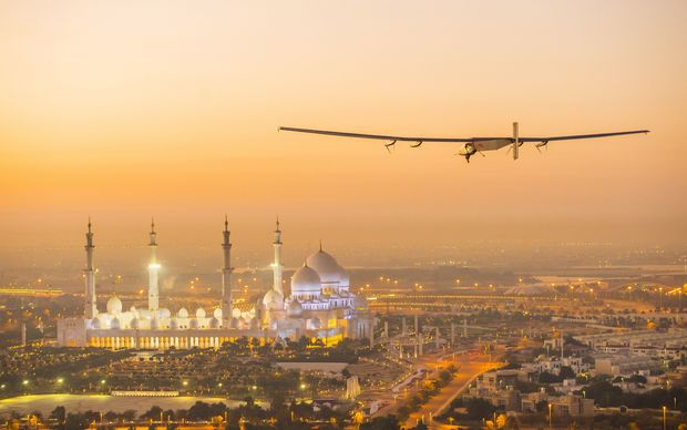 Solar Impulse 2 flying over Abu Dhabi on 26 February 2015. The plane made a third successful test flight in the United Arab Emirates on 2 March.