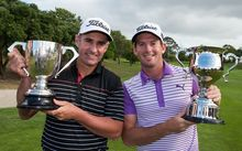 Australia`s Matthew Millar with the Winners Cup, left, and New Zealand`s Josh Geary with the Sir Bob Charles Cup for being the leading New Zealander at the NZ PGA Championship, Remuera Golf Club, March 08, 2015.