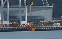 Lifting out the last container that fell into Wellington Harbour after high wind pushed them in on Friday.