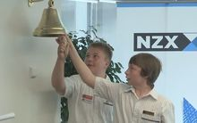 Students ring in Global Money Week at the NZX on 9 March 2015.