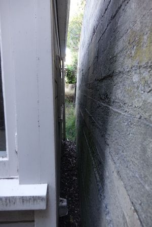 A retaining wall once 1.5 metres away moves to within a few centimetres of the house.