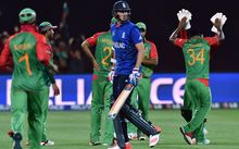 Bangladeshi players celebrate the dismissal of England batsman Stuart Broad during the match at the Adelaide Oval.
