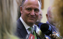 Prime Minister John Key speaking to journalists