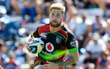 The Warriors fullback Sam Tomkins in action.