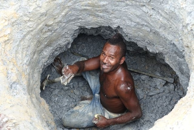 An artisinal gold miner from Nusuta village in Solomon Islands Guadalcanal Province digs for ore in Gold Ridge's pit 3 also known as Kupers.