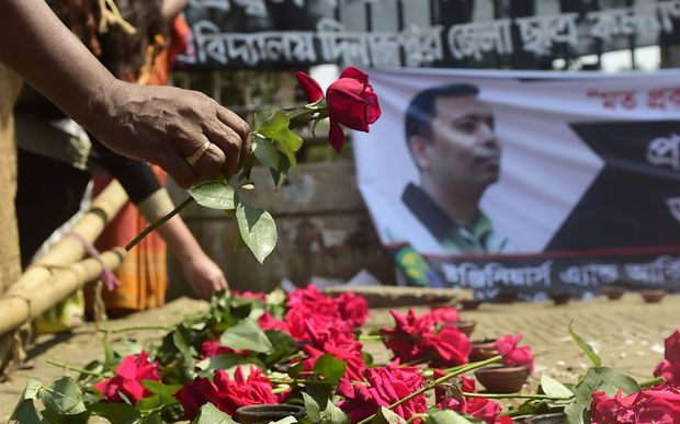 Supporters pay tribute to the slain founder of the Mukto-Mona (Free-mind) blog site, Avijit Roy, in Dhaka.
