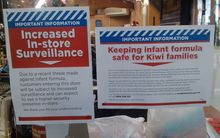 Signs at Thorndon New World on 1080 infant formula threat, Wednesday 11 March.