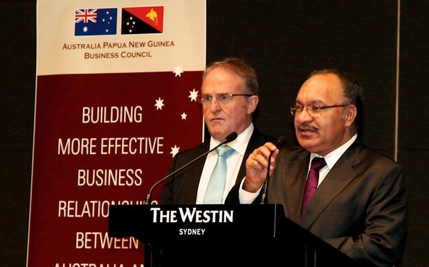 Papua New Guinea Prime Minister Peter O'Neill (right) with Ian Clarke, Past President, Australia PNG Business Council.