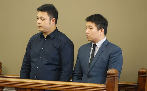 Chinese tourist Jing Cao. Charged with the death of a five-year-old Oamaru girl. Court appearance 13 March 2015. Solicitor Kane Wang (right) who was there to interpret.