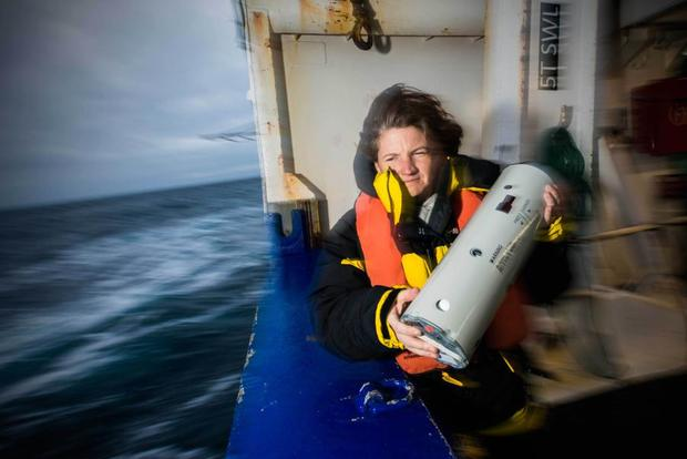 Susie Calderman from the Australian Antarctic Division deploys a sonobuoy to tune into the song of blue whales.