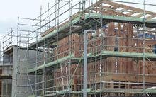 House being built surrounded by scaffolding