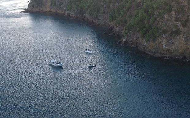 Boats searching at the scene of the helicopter crash.