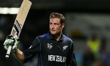Martin Guptill acknowledges the crowd after scoring a century.