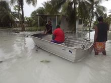 Tuvalu - locals assessing damage following flooding