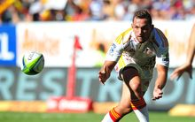 Aaron Cruden has eyes only for the ball