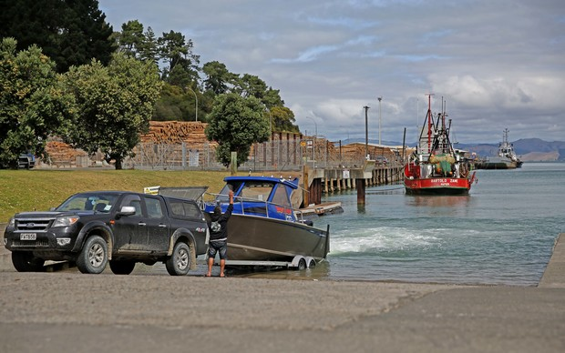 Calling it a day as fishermen bring their boat into the port of Gisborne.