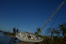 Yacht thrown up on the shore near Port Vila, Vanuatu after Cyclone Pam, March 2015