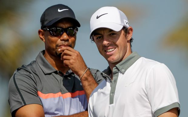 Tiger Woods (L) with Rory McIlroy