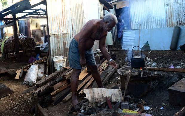 Residents clean up their homes in Port Vila.