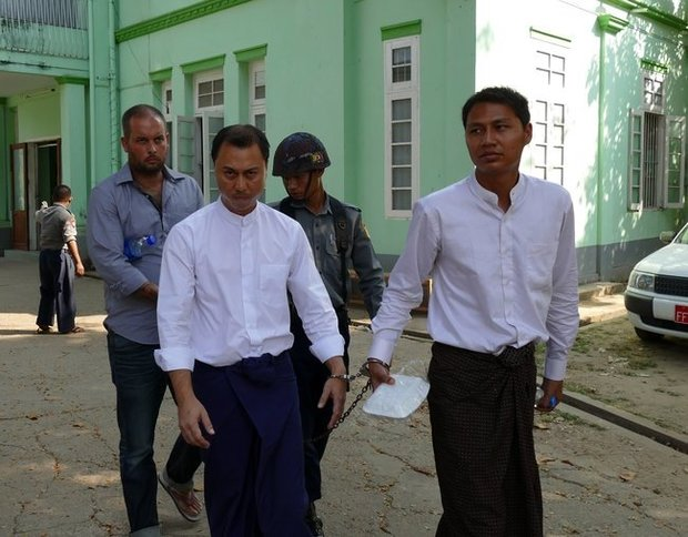 Phillip Blackwood (left) led into court in Yangon with Tun Thurein and Htut Ko Ko Lwin.