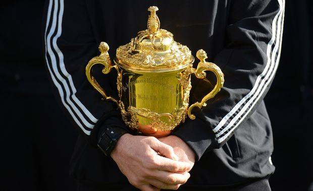 The All Blacks captain Richie McCaw holds the Rugby World Cup. (The Webb Ellis Trophy).