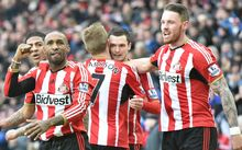 Sunderland players celebrate scoring a goal.