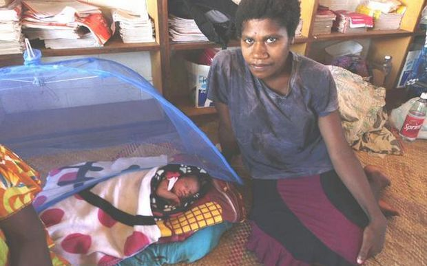 Atel Yalu with her baby Pamina, born the morning Cyclone Pam struck. Their home was destroyed  and the family's future is uncertain.