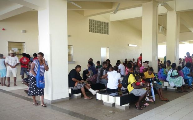 People wait to be seen at the main hospital in Port Vila after Cyclone Pam. One wing was left standing.